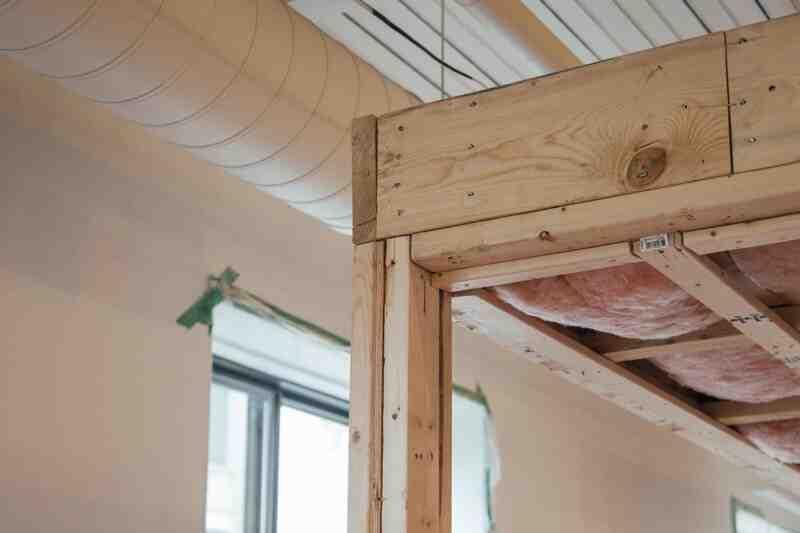 Quelle épaisseur de la paroi du cadre en bois?